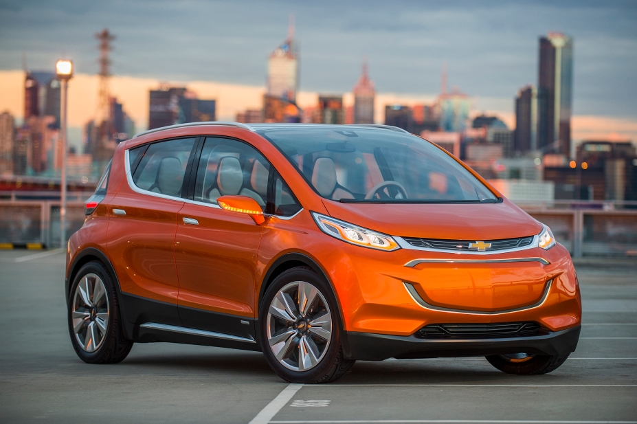 2015 Chevrolet Bolt EV Concept all electric vehicle. Front ¾ in city scape. Bolt EV Concept builds upon Chevy's experience gained from both the Volt and Spark EV to make an affordable, long-range all-electric vehicle to market. The Bolt EV is designed to meet the daily driving needs of Chevrolet customers around the globe with more than 200 miles of range and a price tag around $30,000. © General Motors