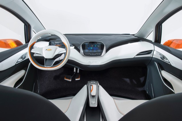 2015 Chevrolet Bolt EV Concept all electric vehicle interior. Unique crossover proportions provide a calm, welcoming interior blending technology and efficiency with a roomy, airy feel. Glass roof, thin seat design, aluminum seat structure, flow-through flat floor, anodized orange accents and 10 inch capacitive touch screen. © General Motors